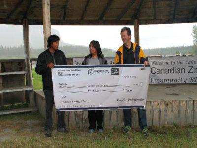 Alan Taylor presents Nahanni Flood Relief Fund cheque to Chief Clayton and Councillor Tammy Matou